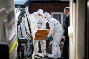 Gardai remove Ann Butler's body from her home in Maudlin Street, Kilkenny city