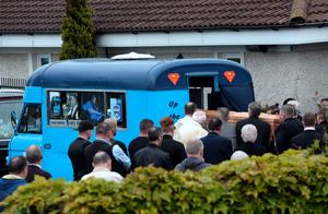 General view of coffin being carried from church. Funeral of Stephen (Steve) Harris, Divine Mercy Church, Balgaddy, Dublin