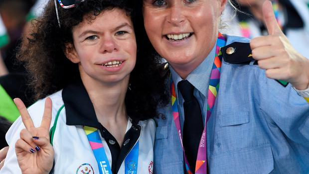 Team Ireland's Ashleigh O'Hagan, a member of Lisnagry Special Olympics Club, from Limerick City, with Garda sargent Michaela Moloney, from Henry Stree station, Limerick,