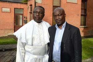 Superior Evangelist Michael Afolalu and Shepard of the Church Paul Enahoro pictured outside the home of Shetemi Ayetigbo who died suddenly on Sunday during a football match.