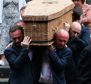 Paul Morrissey (left) helps carry the coffin of his wife Ruth Morrissey