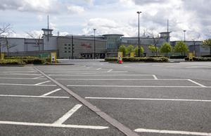 An empty Liffey Valley Shopping Centre car park yesterday afternoon due to virus lockdown