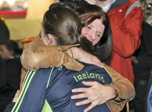 Katie Taylor is welcomed home by her mum, Bridget pictured at Dublin Airport after arriving home after winning her fifth World Title in Korea