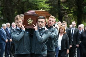 Members of the current Dublin Senior football team at the funeral mass of Anton O'Toole
