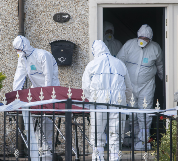 Thomas McCarthy's body is removed from the scene yesterday