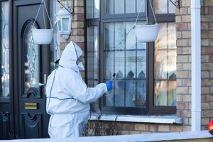A garda forensics officer at the house in Oranmore Road, Ballyfermot, where Bridie Smith was stabbed