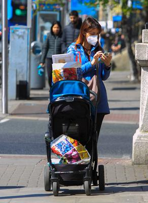 Dubliners out for a stroll yesterday using face masks to protect themselves