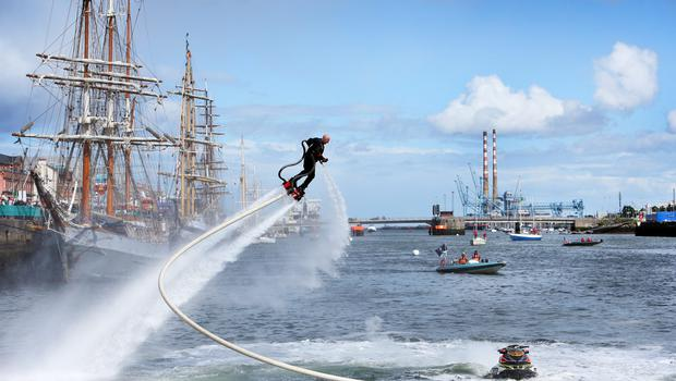 Flyboarder Jay St John from Iiverpool using a Flyboard on the Liffey during the Tall Ships Festival.
