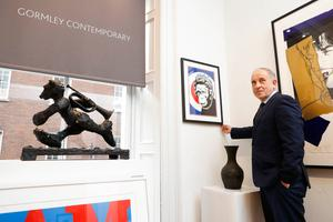 Oliver Gormley shows off a Banksy