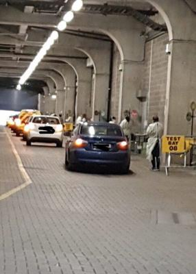 Cars in the tunnel in Croke Park yesterday as people availed of the drive-through coronavirus test station