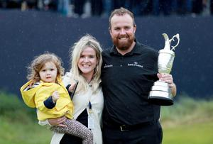 Shane Lowry poses with his wife Wendy and daughter Iris