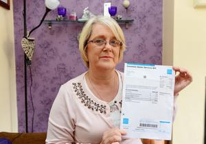 Mary O'Brien died in January 2009 but has received a bill for water from Irish Water. Mary's daughter Angela Murtagh (pictured) says her mother would have been 96 if she was alive and is pictured with her mothers bill
