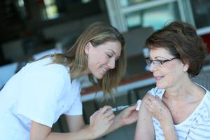 A woman receives her annual flu jab