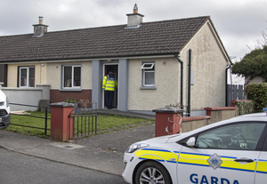 Gardai begin their investigation at the house in Kells, Co Meath, where John 'Boy' Power and Martin 'Biggy' Reilly died from suspected smoke inhalation