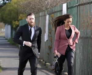 Conor McGregor and Dee Devlin arrive for the funeral of his aunt, Ann Moore