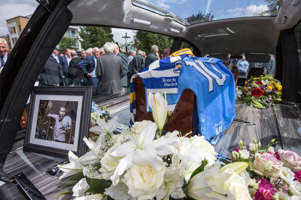 Templeogue Synge Street jersey and the Dublin Number 10 jersey are placed on the coffin of Anton O'Toole