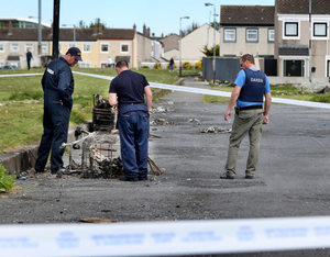 Gardai at the scene of the attack in Darndale               yesterday