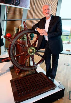 James Cameron with the ship's wheel from the film at Titanic Belfast
