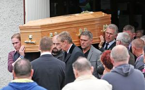 The remains of Steve Harris (34) - who tried to rescue his brother, father-of-two Alan Harris (45) - was also overcome by the fumes in the incident in a sewer at Drumnigh Wood estate in Portmarnock, Co Dublin on Wednesday afternoon pictured being carried from the Divine Mercy Church, Balgaddy, Lucan this morning after his funeral mass
