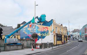 A mural is painted on Bridge Street in Balbriggan Co Dublin, to mark the centenary of the sacking of the town by British soldiers in 1920