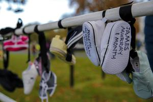 Children's shoes left at a protest outside Aras an Uachtarain after the law was passed