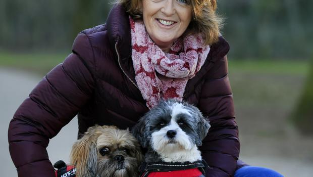 Terry O'Reilly with her dogs Poppy and Lily. Photo: Gerry Mooney