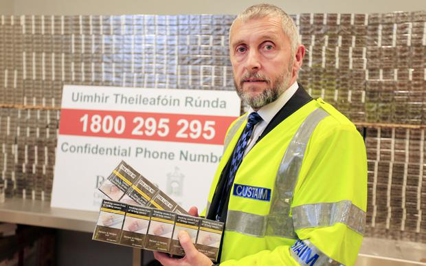 Senior customs officer Joe Keane pictured with some of the recent seized haul in the cargo area of Dublin Airport