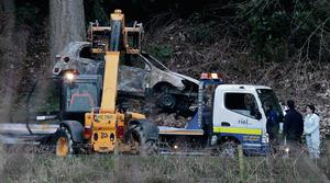 SCENE:The burnt out car being removed from  the carpark of Ravelsdale forest  outside Dundalk,