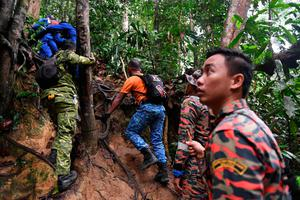 Members of a rescue team searching for missing 15-year-old Nora Quoirin in the jungle near Malaysian resort on August 12, 2019. Photo: Getty Images