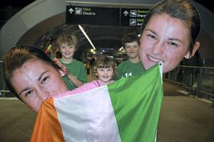 Fans Gearoid, 9, Elsha, 6 and Oisin Murphy, 8, Bray at Dublin airport to welcome home Katie Taylor who won her fifth consecutive World Championship in South Korea