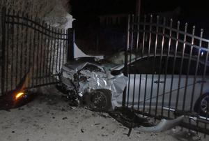 The car after it crashed into the gates of singer Taylor Swift's beachfront home