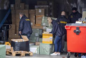 Gardai remove boxes of suspected conterfeit products seized in the raid.