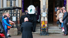 The coffin of Noah Donohoe is carried into St Patrick's Church in Belfast