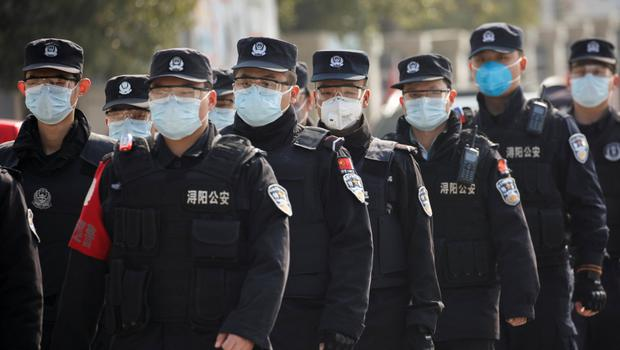 Security personnel at a checkpoint in Jiujiang, China. Photo: Reuters