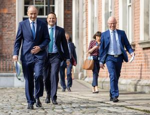 The Taoiseach, Tánaiste and Health Minister arriving at the unveiling of the 'Living with Covid' plan shortly before Stephen Donnelly was taken ill and tested for Covid-19