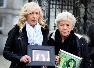Antoinette Keegan and her mother Christine with photos of Mary and Martina. Photo: Tom Burke