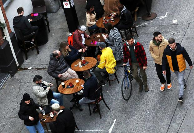 Punters get some last-minute pints in on Dublin's Exchequer Street yesterday