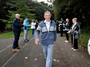 Michael Connolly reaches the finish line of his 125km walk in St Anne's Park