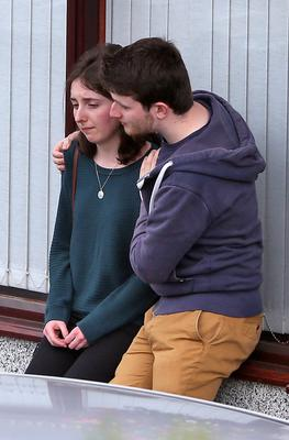 Friends console each other outside Fanagan's Funeral Home, Dundrum this afternoon where the remains of Berkeley balcony collapse victim, Eimear Walsh are reposing prior to her funeral mass which will take place at in the Church of Our Lady of Perpetual Succour in Foxrock in Dublin tomorrow