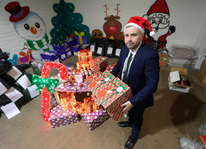 Anthony Flynn of ICHH with some of his elves' Santa boxes