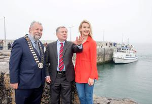 Actress Aoibhinn Garrihy whose family run Doolin2Aran Ferries at Doolin Pier Co Clare shares her local knowledge with Minister Brendan Howlin and Cathaoirleach of Clare County Council John Crowe during the Official opening of the new €6m Pier at Doolin, Co. Clare, by Brendan Howlin, T.D., Minister for Public Expenditure & Public Reform. Photo: Arthur Ellis.