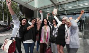 Daughters of sick James O'Reilly embrace outside court after he was jailed for 20 years. Photo: Collins