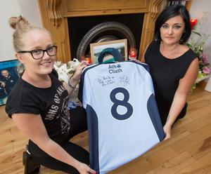 Treacy Harris (right) and her daughter Nicole pictured with the signed Dublin Jersey at their Clonee home yesterday.
