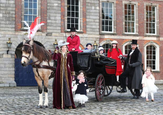 Joanne Bannon with her daughter Clara Bannon Mateus joined by Christian Feehan, Fainche Tobin (3), Rian Hennessy (7), Ethan Groark (10) and Roisin O'Carroll (10) at Dublin Castle for the launch of 'Christmas At The Castle'
