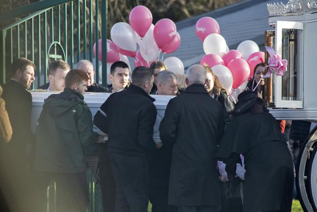 The coffin of Annmarie Hooper is carried from the church