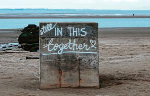 Graffiti at Burrow Beach in Sutton showing solidarity during the pandemic
