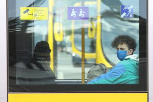 Members of the public wearing face masks on public transport