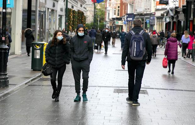 Masked shoppers in the city as outbreaks in homes rise