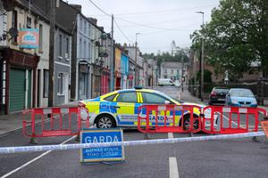 Gardai at the scene where Det Gda Horkan died. Photo: PA