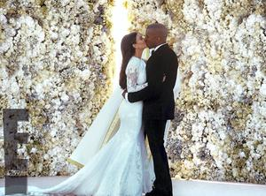 GOWN: Kim Kardashian and Kanye West kissing at their wedding in Florence. Photo: PA